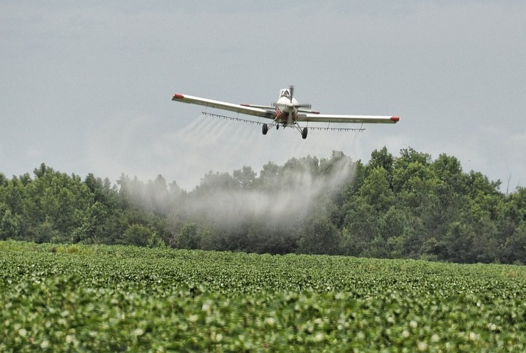 Crop duster spraying pesticidies