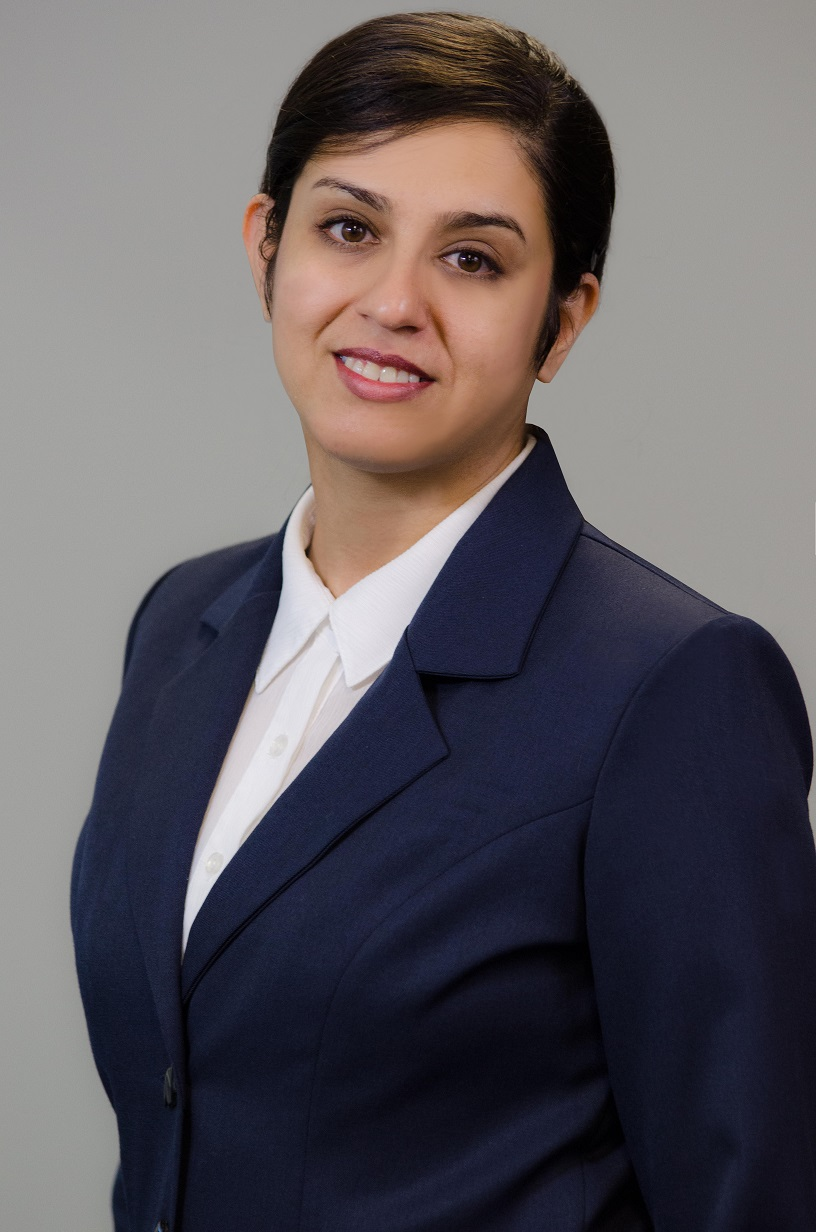 Portrait of Dr. Farzaneh Khorsandi a woman with brown hair in a blue suit with a white shirt