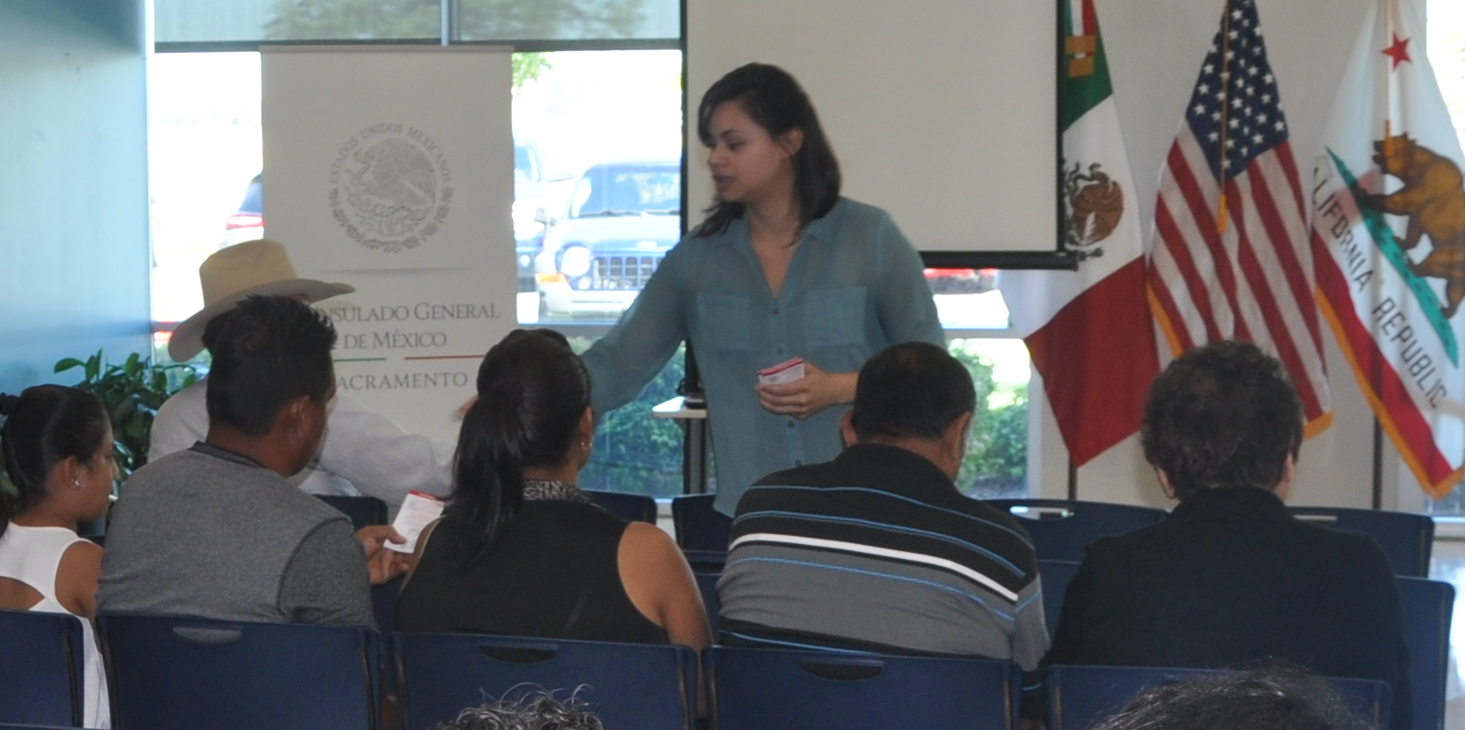 Leslie Olivares interacting with people at the Mexican Consulate