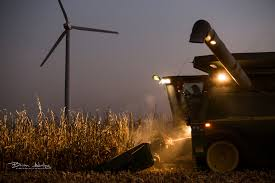 Tractor in corn field at night