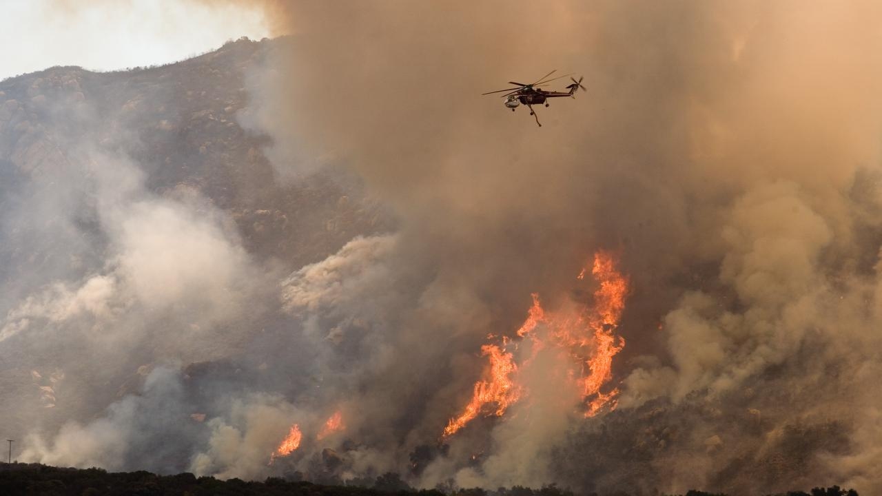 Helicopter Drops Water on Wildfire