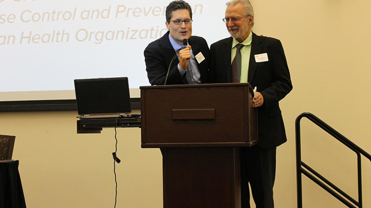 Conference organizers Giovanni Peri (Migration Research Cluster) and Marc Schenker (Migration & Health Research Center) thank MLGH participants.