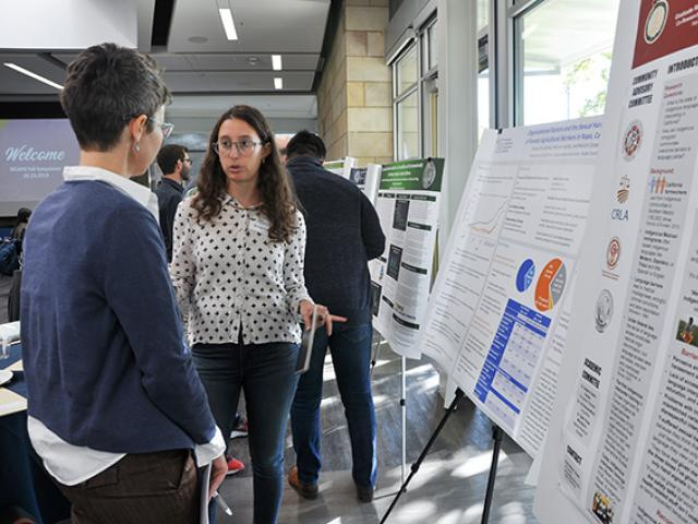 Emanuelle Klachky discusses her poster at the 2018 Symposium