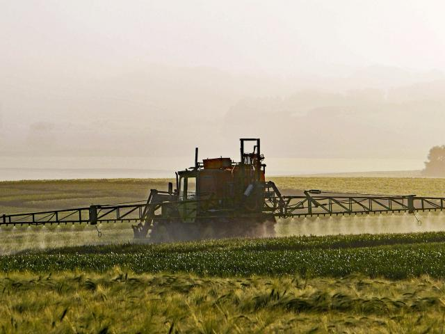 Pesticides Sprayed on Large Field