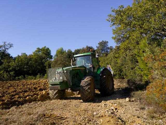 Tractor in agricultural field on a sunny day
